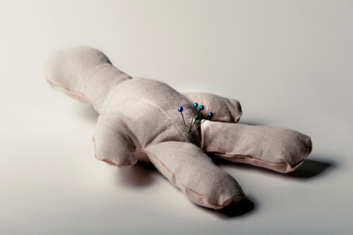 Lying On Back「Close-up of a voodoo doll with straight pins on its crotch」:スマホ壁紙(14)