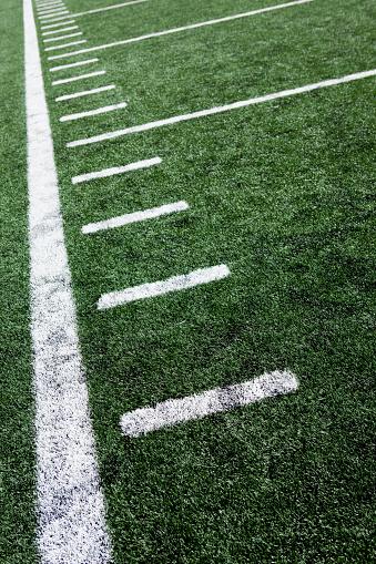 Traditional Sport「Close-up of football stadium markings on artificial grass」:スマホ壁紙(9)