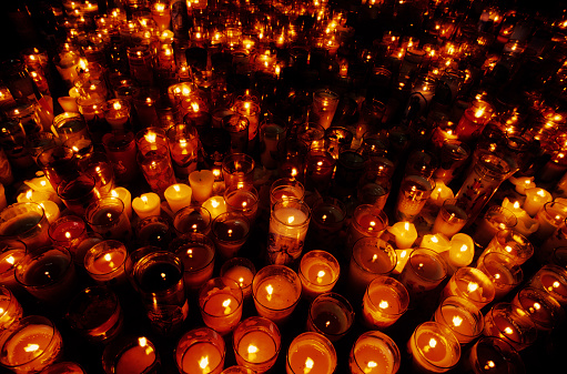 Spirituality「A close-up of multiple candles in a vigil」:スマホ壁紙(2)