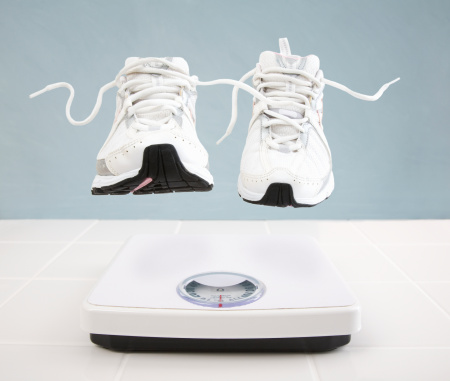 Hovering「Running shoes hovering above bathroom scale」:スマホ壁紙(5)