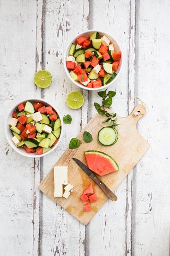 スイカ「Watermelon salad with feta, cucumber, mint and lime dressing on white wood」:スマホ壁紙(5)