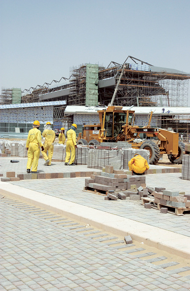 Mid Adult「Dubai Autodrome under construction at the Dubailand, Dubai, United Arab Emirates, September 2004. Transforming 7.5km of sandy desert in the heart of Dubai into a world class F1 circuit is no mean feat but to create it in only six months is super speedy.」:写真・画像(16)[壁紙.com]