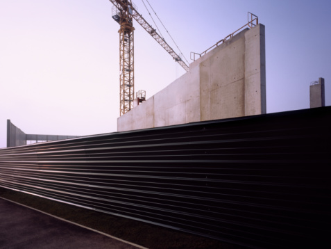 Corrugated Iron「Corrugated metal fence with construction site at dawn.」:スマホ壁紙(6)