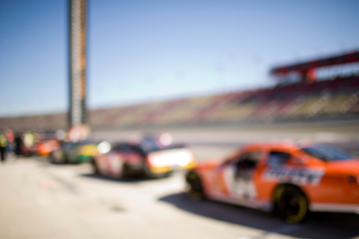 Motor Racing Track「Race cars lined up in pits, (defocused)」:スマホ壁紙(17)