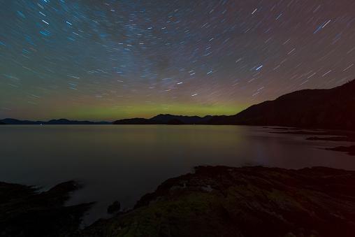 star sky「Northern Lights glowing on horizon with star trails, Settlers Cove State Park, Ketchikan, Alaska, USA」:スマホ壁紙(16)