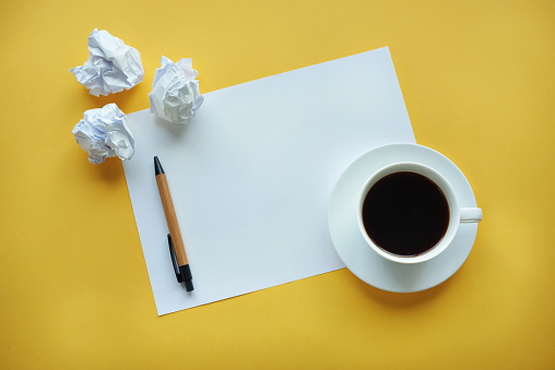 Coffee Break「Crumpled up papers on a table by cup. Debica, Poland 」:スマホ壁紙(4)