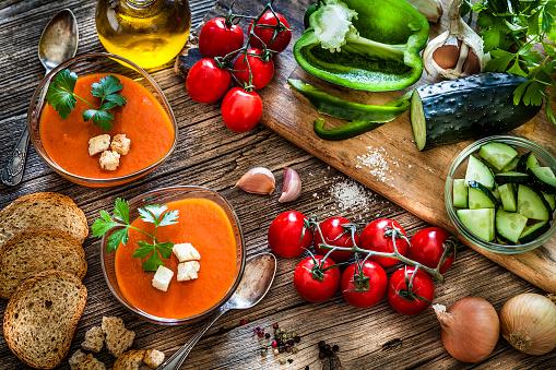Mediterranean Food「Spanish gazpacho and ingredients on rustic wooden table」:スマホ壁紙(10)