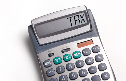 Tax「Tax written on a calculator」:スマホ壁紙(13)