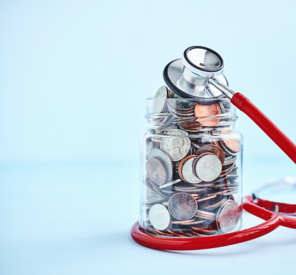 Financial Report「Jar filled with coins wrapped with stethoscope. Financial health concept」:スマホ壁紙(9)