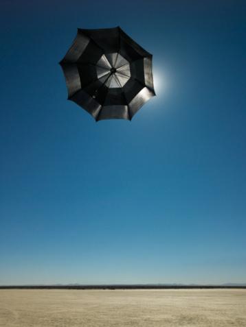 Hopelessness「Umbrella flying in wind over desert」:スマホ壁紙(18)