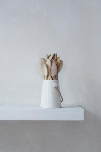 Brighton - England「A ceramic jug containing wooden spoons.」:スマホ壁紙(16)