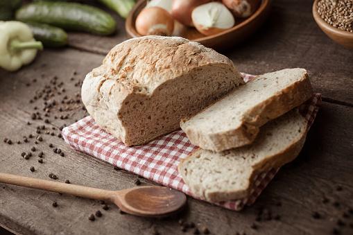 Loaf of Bread「Bread on wooden table」:スマホ壁紙(1)