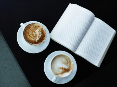 Coffee - Drink「Two cups of cappuccino, and a book, sitting on table.」:スマホ壁紙(6)