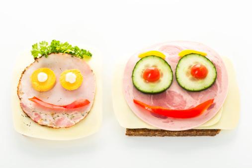 擬人化「Smiley sausage sandwich with cheese and pepper on white background」:スマホ壁紙(3)