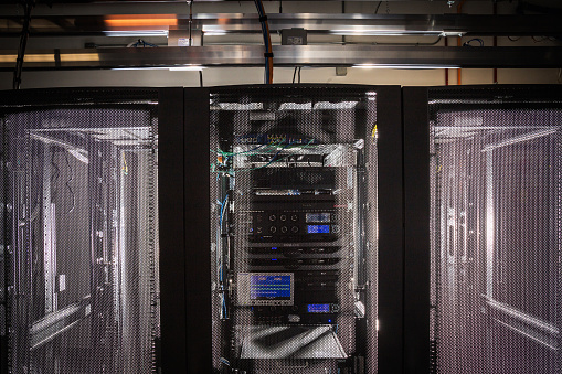 Data Center「Server room racks glowing from behind」:スマホ壁紙(16)