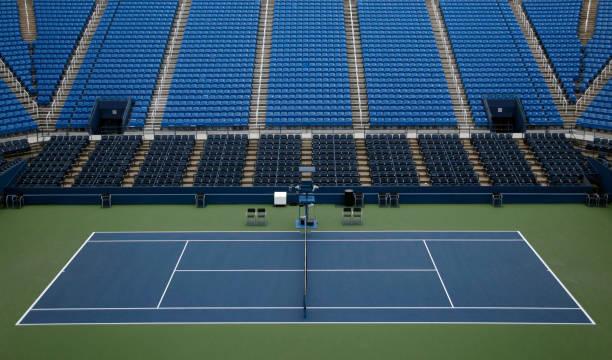 Empty tennis stadium with seats:スマホ壁紙(壁紙.com)