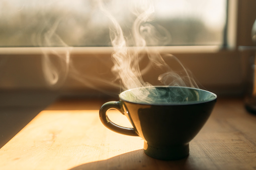 Sun「Steam rising from freshly prepared coffee in cup on table at home」:スマホ壁紙(7)