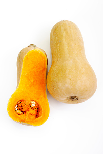 Part Of「Whole and a half of butternut squash in front of white background」:スマホ壁紙(4)