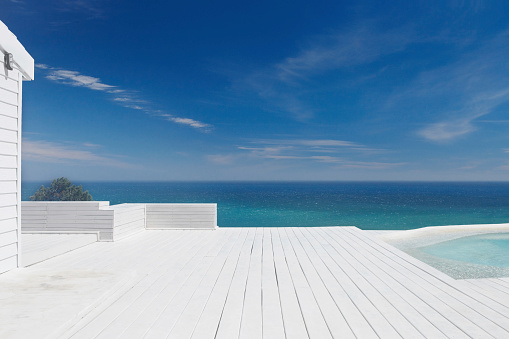 Awe「Deck at a resort by a swimming pool and sea」:スマホ壁紙(1)