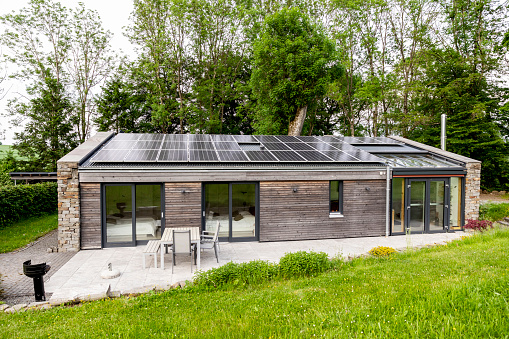 Solar Energy「Detached house with solar panels on the roof」:スマホ壁紙(5)