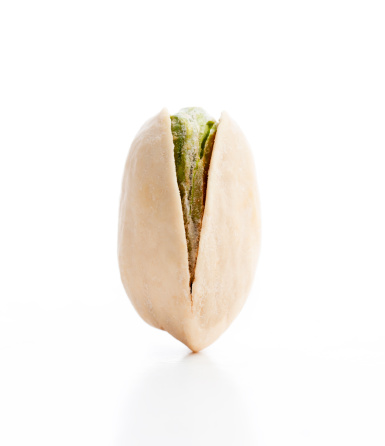 Salted「Vertical View of a Balanced Single Pistachio Nut」:スマホ壁紙(6)