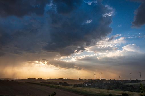 Dramatic Landscape「Germany, Lausitz, wind wheels and  thundercloud」:スマホ壁紙(6)
