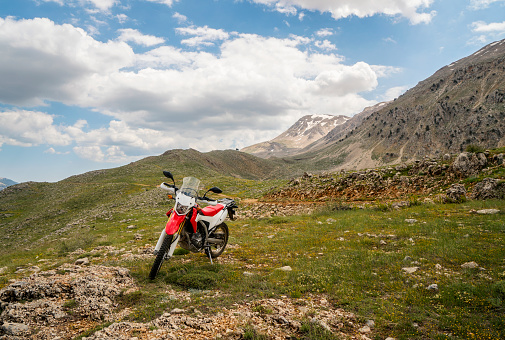 Motorcycle「Enduro Motorcycle on the mountain road」:スマホ壁紙(1)