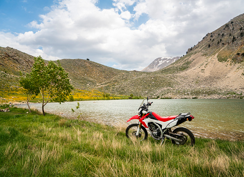 Motorcycle「Enduro Motorcycle on the mountain road」:スマホ壁紙(0)