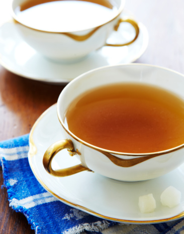 Tea「Hot tea in cups on saucers with sugarcubes.」:スマホ壁紙(9)