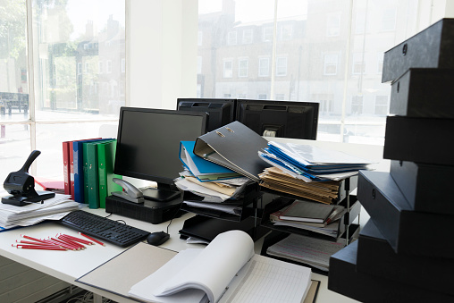 Document「An ordinary office with piles of paperwork」:スマホ壁紙(11)