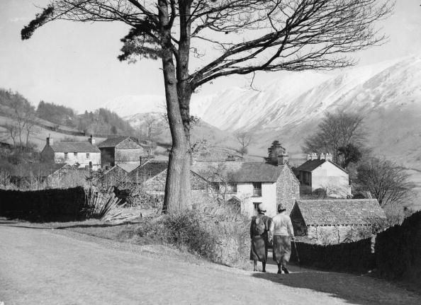 Village「Two hikers in Troutbeck Village, In the background the snow covered Kirkstone Pass, Lake District, Great Britain, Photograph, 1935」:写真・画像(5)[壁紙.com]