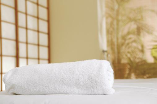 Massage Table「Rolled-up towel on massage table」:スマホ壁紙(7)