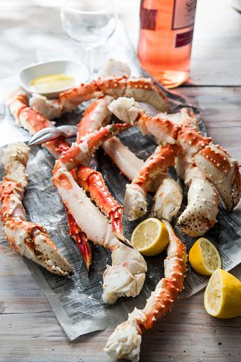 Leg「Crab legs and lemon slices on newspaper」:スマホ壁紙(15)