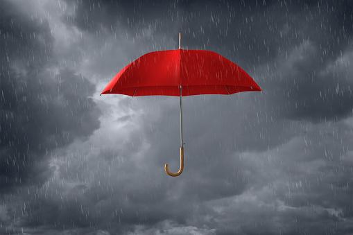 雨「Red umbrella floating in storm clouds」:スマホ壁紙(11)