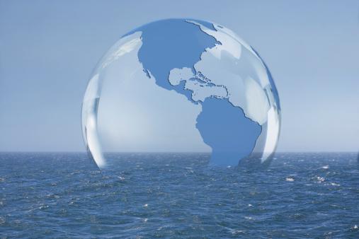 Digitally Generated Image「Transparent globe floating on ocean」:スマホ壁紙(13)