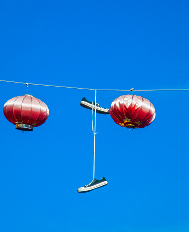 Chinese Lantern「Sneakers hanging from a string with Chinese lanterns」:スマホ壁紙(3)