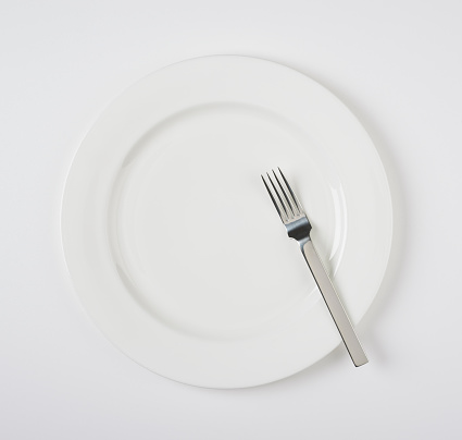 Fork「A simple image of a fork on a plain white plate on a natural white background, including soft shadow」:スマホ壁紙(15)