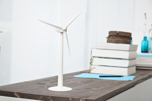 Wind Turbine「Germany, North Rhine Westphalia, Modern windmill and stack of books on table」:スマホ壁紙(7)