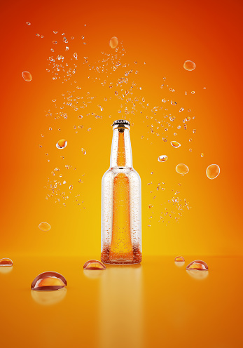 Drinking「Orange bottle with water drops on yellow background」:スマホ壁紙(19)
