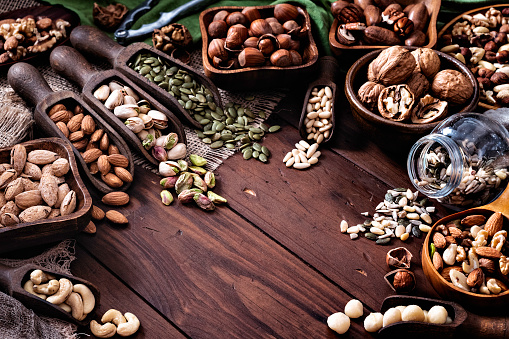 Pine Nut「Variety of dried fruit and nuts on a table in a old fashioned rustic kitchen」:スマホ壁紙(7)