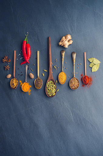 Paprika「Variety of herbs and spices on slate background.」:スマホ壁紙(3)