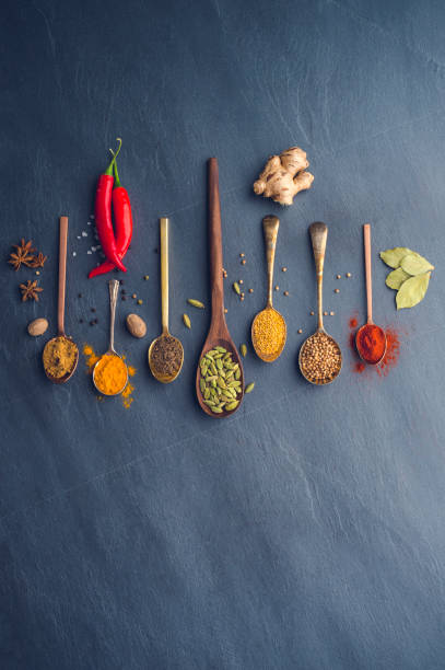 Variety of herbs and spices on slate background.:スマホ壁紙(壁紙.com)