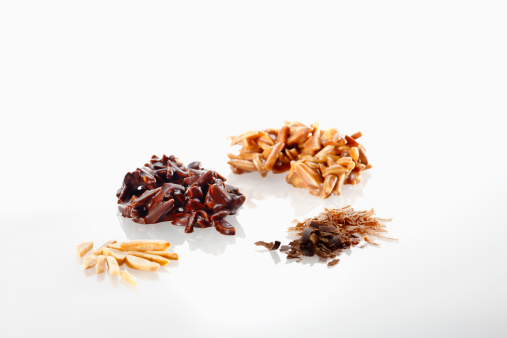 Milk Chocolate「Variety of chocolate with almond pieces on white background」:スマホ壁紙(19)