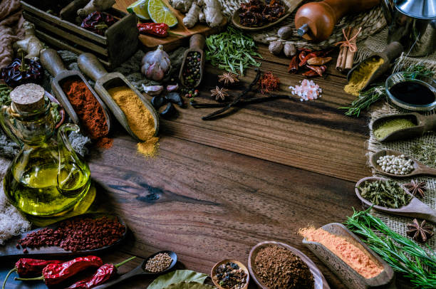 Variety of allspice ingredients and condiments for food seasoning on table in old fashioned kitchen:スマホ壁紙(壁紙.com)