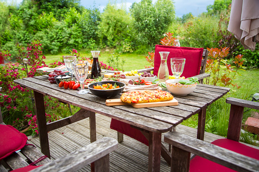 Picnic Table「Variety of Mediterranean antipasti on garden table」:スマホ壁紙(12)