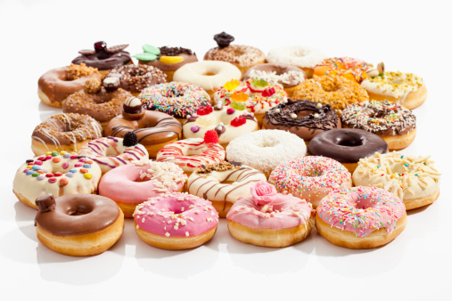 ドーナツ「Variety of doughnuts topped with icing and sprinkles on white background」:スマホ壁紙(9)
