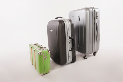 Suitcase「Variety of suitcases and luggages in a row against white background」:スマホ壁紙(19)