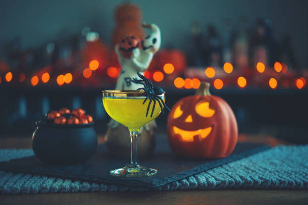Halloween time. Vibrant colored drinks with cauldron of candy:スマホ壁紙(壁紙.com)