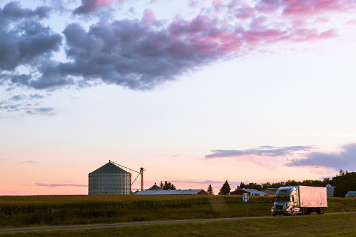 Remote Location「Colorful sunset over farm in rural landscape」:スマホ壁紙(8)