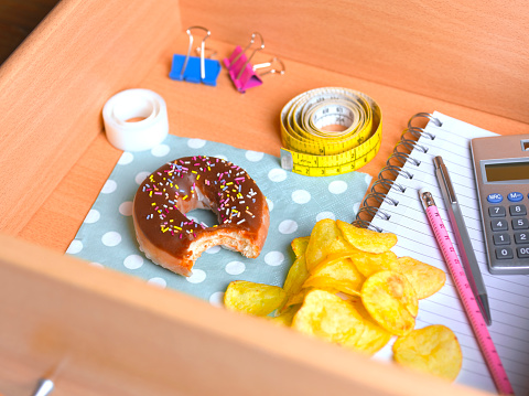 Caught In The Act「Doughnut and potato chips in office desk」:スマホ壁紙(15)